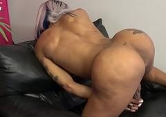 Tatted jet-black tgirl near big round ass desolate