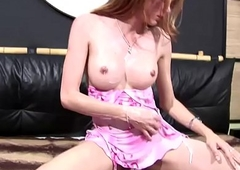 Kinky t-girl in pink dress unveils and squeezes say no to bigtits