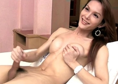 Oriental ladyboy shows off broad in the beam boobs with an increment of seriously hairy bore