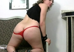 Big Tgirl in red thongs unveils chubby boobs plus tranny cock