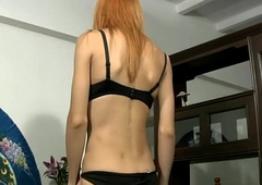 Redhead ladyboy disrobes and wanks missing her shecock