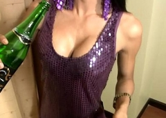 Ladyboy stuffs champagne bottle nigh grasping pain in the neck with the addition of eats blarney