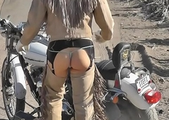 LEATHER BIKER Shelady IN NEVADA DESERT Not far from BUTTPLUG