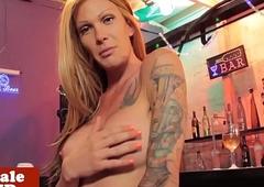 Tattooed tilf strokes her cock in public